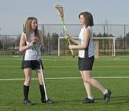 Jogadores do lacrosse das meninas Foto de Stock Royalty Free