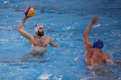 Jogadores do polo aquático Imagens de Stock