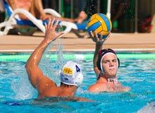 Jogadores do polo de água na ação Imagens de Stock Royalty Free