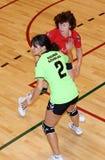 Jogadores não identificados do handball na ação Fotografia de Stock Royalty Free