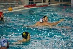 Jogadores na ação no jogo do polo aquático Fotos de Stock Royalty Free