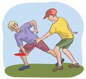 Jogadores que travam o frisbee Imagem de Stock