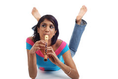 Jogando a flauta imagem de stock royalty free