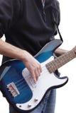 Jogando a guitarra baixa Fotografia de Stock