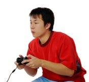 Jogando jogos de computador Imagens de Stock