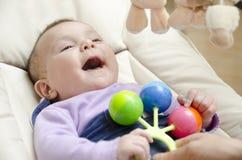 Jogando o bebê. Fotografia de Stock