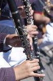 Jogando o clarinete Imagens de Stock