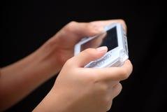 Jogando o console portátil Imagens de Stock Royalty Free