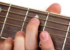 Jogando o fretboard da guitarra Fotografia de Stock