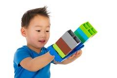 Jogando o menino chinês imagens de stock