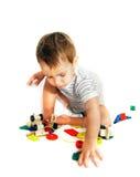 Jogando o menino sobre o branco Imagem de Stock Royalty Free