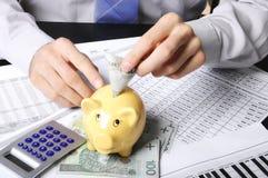 Jogando o money-saving Imagens de Stock