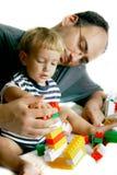 Jogando o pai e o filho imagens de stock