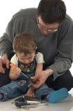 Jogando o pai e o filho imagem de stock