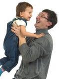Jogando o paizinho e o filho Fotos de Stock