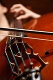Jogando o violoncelo Imagem de Stock Royalty Free