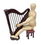 Jogando uma harpa imagens de stock