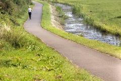 Jogga flickan i Nederländerna Arkivfoto
