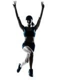 Jogger бегуна женщины скача победоносный силуэт Стоковое фото RF