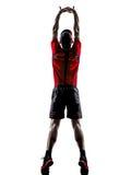 Jogger бегуна протягивая нагревающ силуэт Стоковое Изображение RF