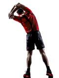 Jogger бегуна протягивая нагревающ силуэт Стоковое Изображение