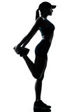 Jogger бегунка женщины протягивая подогрев Стоковое Изображение