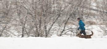 Jogger в снеге Стоковая Фотография