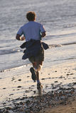 jogger пляжа Стоковая Фотография
