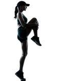 jogger δρομέας που τεντώνει επάνω τη θερμή γυναίκα Στοκ Εικόνες