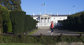 Jogger at Aras an uachtarain. A jogger in front of Aras an uachtarain,the residence of the President of Ireland in Dublin's Phoenix Park Stock Photo
