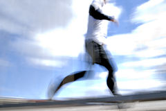 Jogger in blurred motion Royalty Free Stock Images