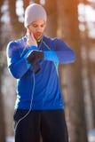Jogger controls heart beats on training outdoor. Male jogger controls heart beats on training outdoor stock photos
