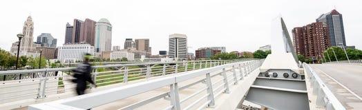 Jogger crosses bridge with Columbus Ohio backdrop Royalty Free Stock Photography