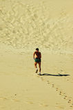 Jogger in desert Royalty Free Stock Photos