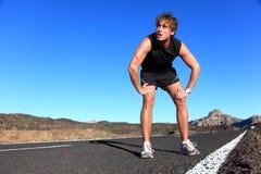 Jogger die na het lopen rust Stock Afbeeldingen