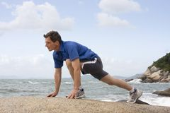 Jogger doing fitness exercises Royalty Free Stock Photography