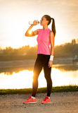Jogger drinking water Stock Photography
