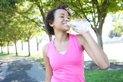 Jogger Drinking Water in Park Stock Photos
