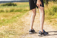 Jogger having muscle pain royalty free stock images