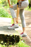 Jogger having problems with ankle Stock Image