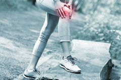 Jogger with hurt knee Royalty Free Stock Photos