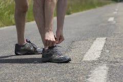Jogger man binding the shoe strings Stock Photo