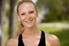 Jogger Portrait. A portrait of a happy female jogger smiling at the camera Stock Photo