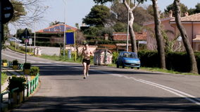 Jogger running on street Stock Photo