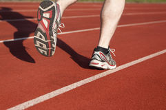Jogger on running track. Male jogger on running track Stock Images