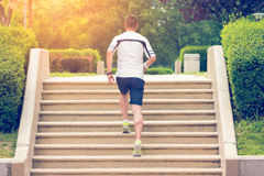Jogger running up on stairs. Muscular sportsman running up on stairs. Morning workout. Urban scene. Fitness, sport, recreation, workout, healthy lifestyle royalty free stock image