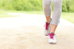 Jogger's legs on the path Royalty Free Stock Photo