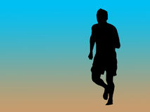 Jogger silhouette. Silhouette of a male jogger on the beach Stock Images