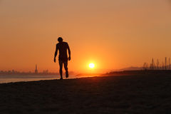 Jogger silhouette walking exhausted after a hard training royalty free stock photos