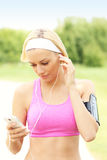 Jogger with smartphone Royalty Free Stock Images